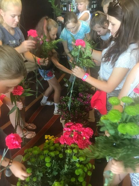 Children from Belarus enjoy making floral presentations for their host families
